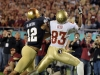 December 29 2011: Robert Blanton #12 plays defense whie Bert Reed #83 catches a touchdown during NCAA football Champs Sports Bowl between Notre Dame Fighting Irish and Florida State Seminoles at Florida Citrus Bowl Stadium, Orlando, Florida.
