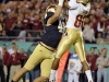 December 29 2011: Dan Fox #48 defends Rashad Greene #80 catching a touchdown during NCAA football Champs Sports Bowl between Notre Dame Fighting Irish and Florida State Seminoles at Florida Citrus Bowl Stadium, Orlando, Florida.