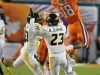 January 04 2011: Jaron Brown #18 attemps to catch a pass over Brodrick Jenkins #23 in action during NCAA football Discover Orange Bowl between West Virginia and Clemson at Sun Life Stadium, Miami Florida.
