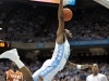 December 21, 2011: P.J. Hairston #15 dunks over Julien Lewis #2 during NCAA Basketball game between the North Carolina Tarheels and Texas Longhorns at The Dean E. Smith Center, Chapel HIll, NC.