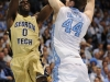 January 29th, 2012:North Carolina Tar Heels forward Tyler Zeller #44 defends Georgia Tech Yellow Jackets guard Mfon Udofia #0 during NCAA basketball game between the North Carolina Tar Heels and the Georgia Tech Yellow Jackets as part of Coaches Vs. Cancer, at The Dean E. Smith Center, Chapel HIll, NC.  UNC Players wore special pink Air Jordans.